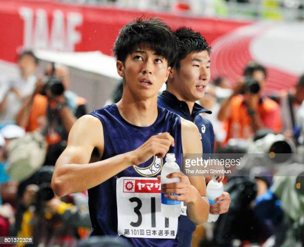 Second finish Shuhei Tada and fourth finish Yoshihide Kiryu look on after competing in the Men's 100m final during day two of the 101st JAAF...