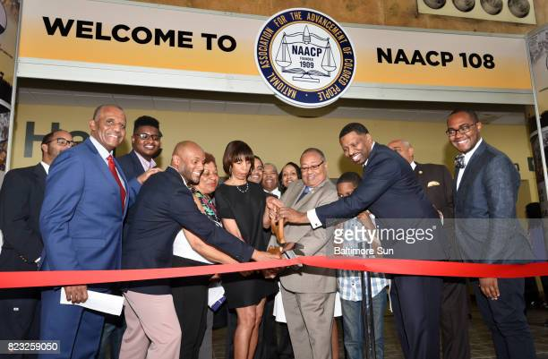 Second from right the NAACPâs interim president and CEO Derrick Johnson joins Baltimore City Mayor Catherine Pugh and Leon W Russell chairman NAACP...