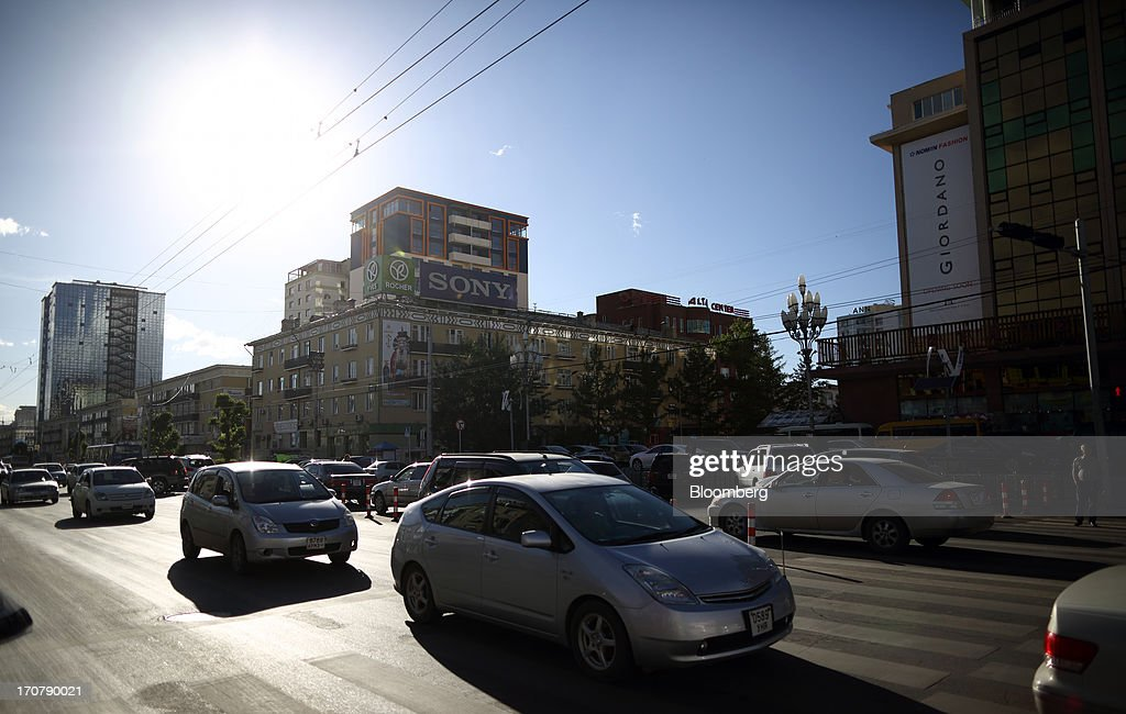 A second generation Toyota Motor Corp. Prius hybrid vehicle, center, drives along in traffic in Ulaanbaatar, Mongolia, on Wednesday, June 12, 2013. Mongolia, a country of almost 2.9 million people, is experiencing double-digit growth and new opportunities in the mining industry. Photographer: Tomohiro Ohsumi/Bloomberg via Getty Images