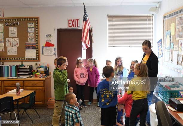 Second grade teacher Sydney Camper does a spell game with her students on April 13 2017 in Westcliffe Colorado Custer County School District is...