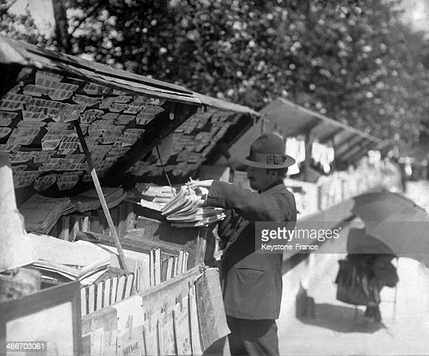 Second hand book seller along the Seine river in 1928 in Paris France