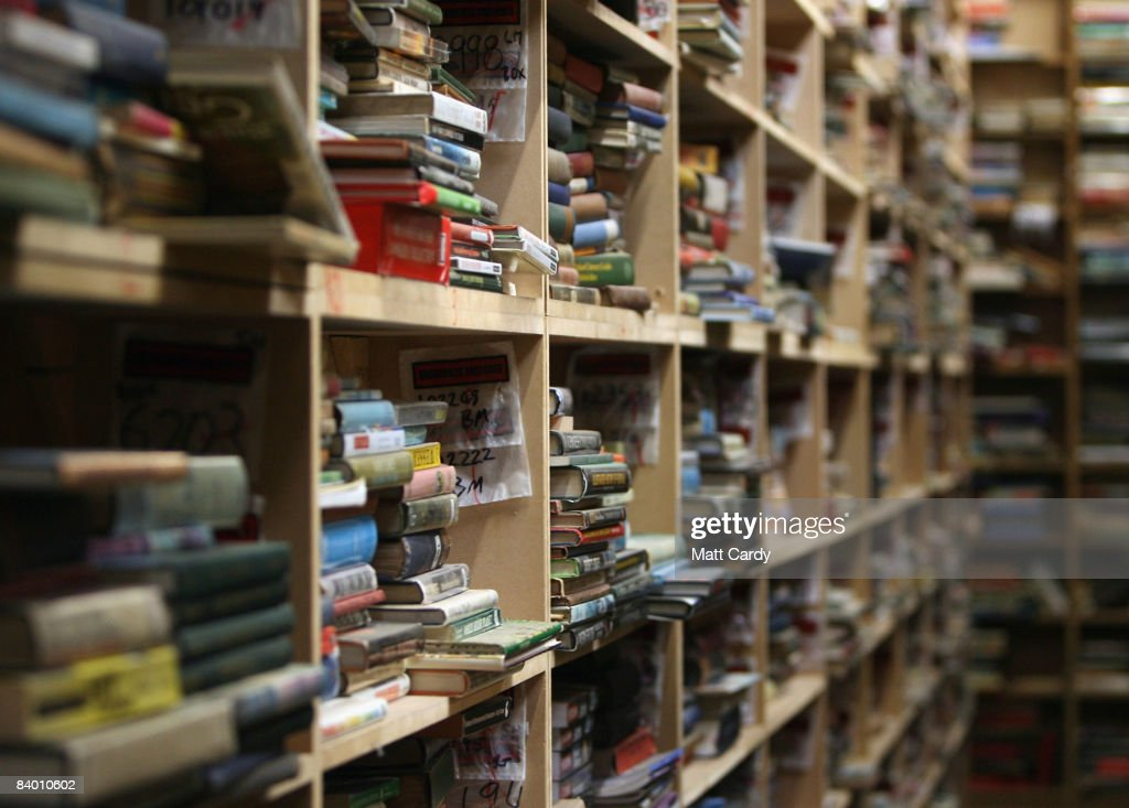 Second hand books are stacked on shelves at the Bookbarn International in one of their warehouses on December 12, 2008 near Hallatrow in Somerset, England. Currently selling up to several thousand books a day and mostly online via Web sites such as Amazon.com, Bookbarn International is the UK's largest second hand book warehouse with over 5 million titles stored in two giant barns in a field in Somerset. Helped in part by the credit crunch, sales of second hand books have risen sharply recently with the weak British pound only helping the Bookbarn to sell more books internationally. (Photo by Matt Cardy/Getty Images).