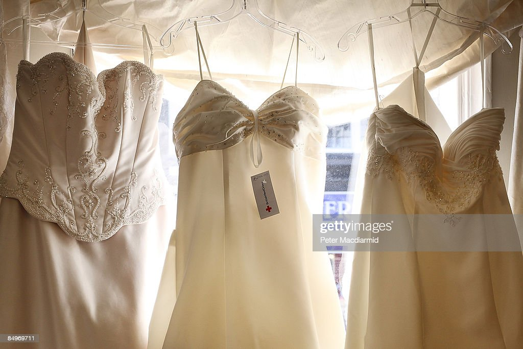 second hand wedding dresses are displayed at the red cross charity bridal on preowned