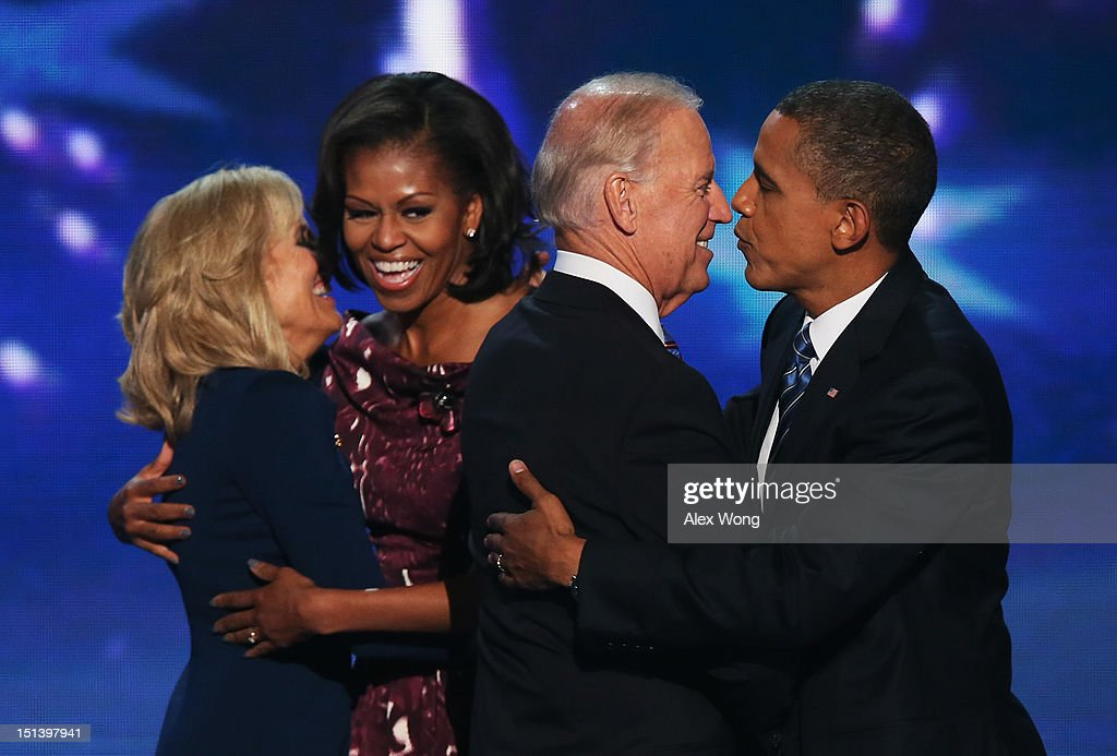 Second lady Dr. <a gi-track='captionPersonalityLinkClicked' href=/galleries/search?phrase=Jill+Biden&family=editorial&specificpeople=997040 ng-click='$event.stopPropagation()'>Jill Biden</a> hugs First lady <a gi-track='captionPersonalityLinkClicked' href=/galleries/search?phrase=Michelle+Obama&family=editorial&specificpeople=2528864 ng-click='$event.stopPropagation()'>Michelle Obama</a>, as Democratic vice presidential candidate, U.S. Vice President Joe Biden greets Democratic presidential candidate, U.S. President <a gi-track='captionPersonalityLinkClicked' href=/galleries/search?phrase=Barack+Obama&family=editorial&specificpeople=203260 ng-click='$event.stopPropagation()'>Barack Obama</a> on stage after accepting the nomination during the final day of the Democratic National Convention at Time Warner Cable Arena on September 6, 2012 in Charlotte, North Carolina. The DNC, which concludes today, nominated U.S. President <a gi-track='captionPersonalityLinkClicked' href=/galleries/search?phrase=Barack+Obama&family=editorial&specificpeople=203260 ng-click='$event.stopPropagation()'>Barack Obama</a> as the Democratic presidential candidate.