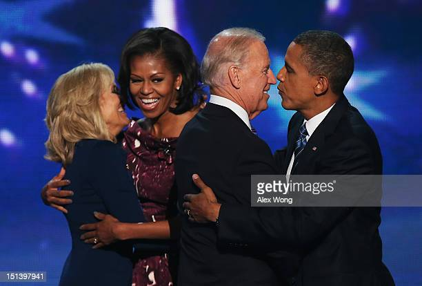 Second lady Dr Jill Biden hugs First lady Michelle Obama as Democratic vice presidential candidate US Vice President Joe Biden greets Democratic...