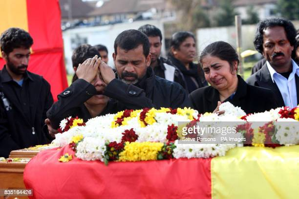Second left Puwaneswary and Kanapathy Varnakulasingham third left the parents of Murugathasan Varnakulasingham 26 from London stand by his coffin...