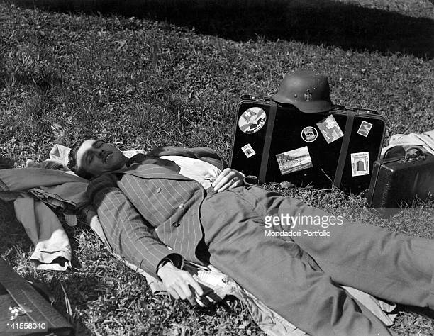 Second lieutenant Telford of the US Air Force lying on grass in civilian clothes after almost one year in a Swiss prison camp France March 1945