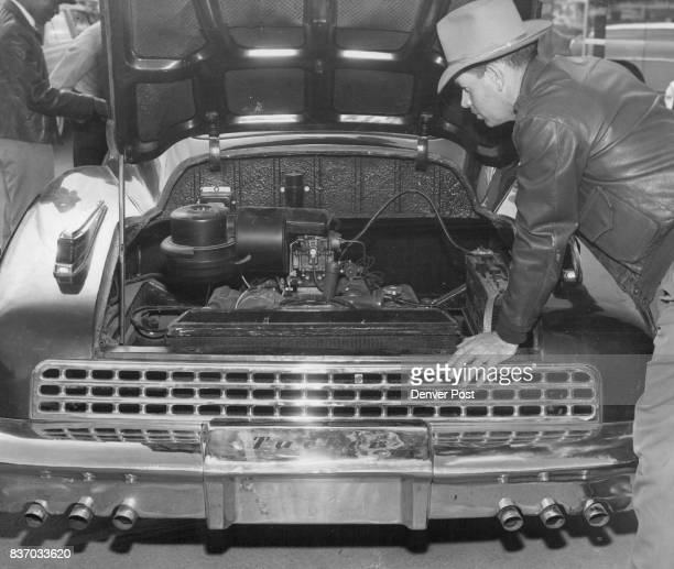 Second Look Robert German who paid $287 in 1948 as a deposit on a Tucker auto takes a look at the rear engine of the Tucker now on sale here Only...