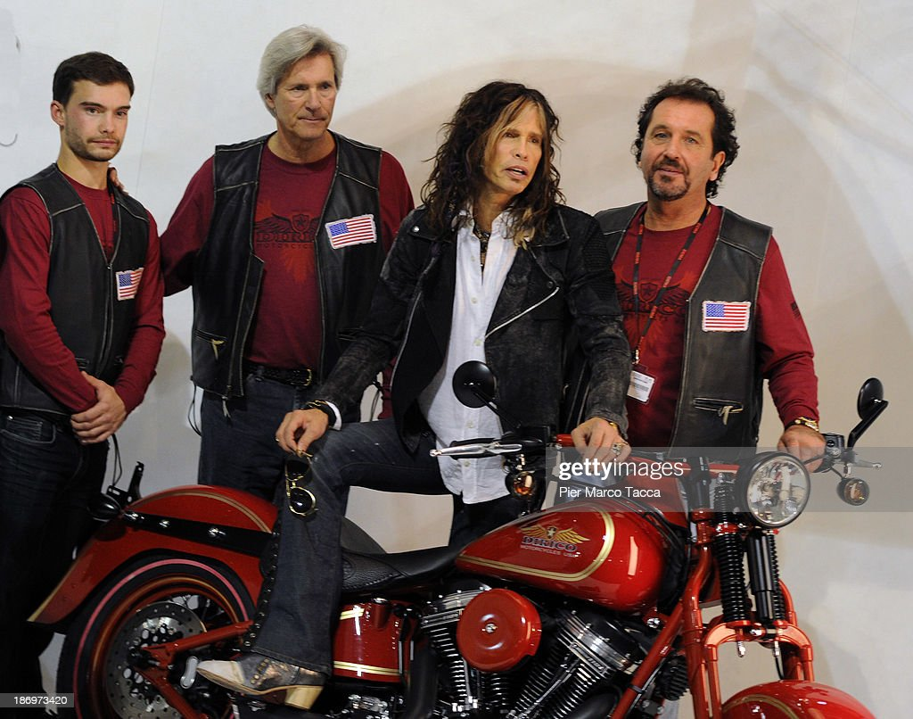 Second on the left Mark Dirico, <a gi-track='captionPersonalityLinkClicked' href=/galleries/search?phrase=Steven+Tyler+-+Musician&family=editorial&specificpeople=202080 ng-click='$event.stopPropagation()'>Steven Tyler</a> and Steven Talarico, <a gi-track='captionPersonalityLinkClicked' href=/galleries/search?phrase=Steven+Tyler+-+Musician&family=editorial&specificpeople=202080 ng-click='$event.stopPropagation()'>Steven Tyler</a>'s cousin, attend Dirico motor presentation during the EICMA 2013 71st International Motorcycle Exhibition on November 5, 2013 in Milan, Italy.