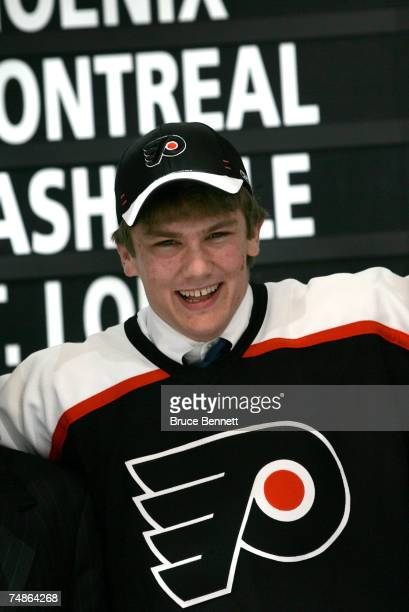 Second overall pick James vanRiemsdyk of the Philadelphia FLyers poses onstage after being drafted in the first round of the 2007 NHL Entry Draft at...