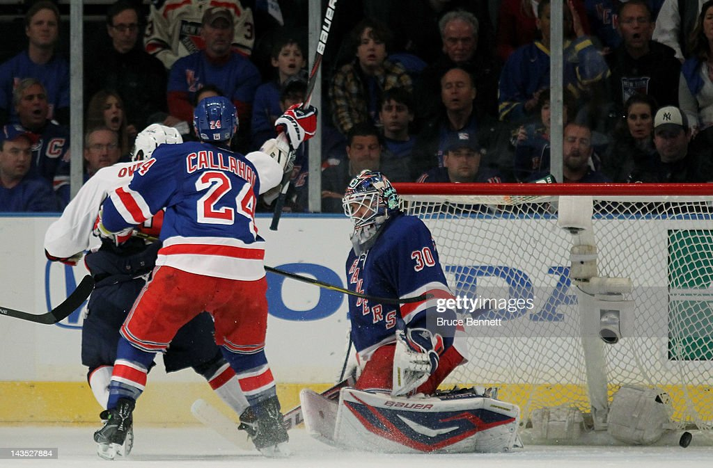 A second period goal by Jason Chimera (not pictured) #25 of the Washington Capitals gets past <a gi-track='captionPersonalityLinkClicked' href=/galleries/search?phrase=Henrik+Lundqvist&family=editorial&specificpeople=217958 ng-click='$event.stopPropagation()'>Henrik Lundqvist</a> #30 and <a gi-track='captionPersonalityLinkClicked' href=/galleries/search?phrase=Ryan+Callahan&family=editorial&specificpeople=809690 ng-click='$event.stopPropagation()'>Ryan Callahan</a> #24 of the New York Rangers as Alex Ovechkin #8 of the Washington Capitals looks on in Game One of the Eastern Conference Semifinals during the 2012 NHL Stanley Cup Playoffs at Madison Square Garden on April 28, 2012 in New York City.