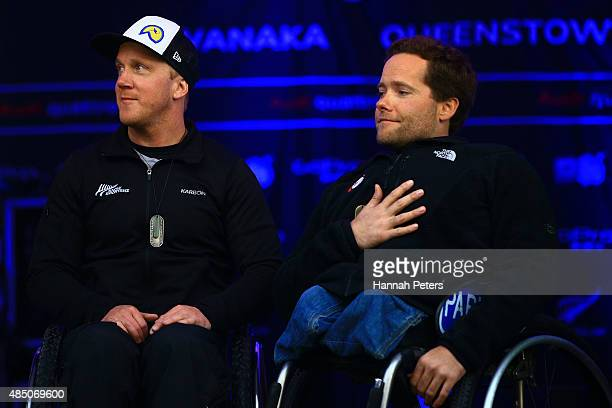 Second place Corey Peters of New Zealand and first place Tyler Walker of the United States pose during the medal ceremony for the Men Slalom Sitting...