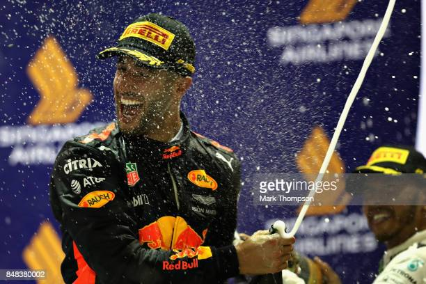 Second place finisher Daniel Ricciardo of Australia and Red Bull Racing celebrates on the podium during the Formula One Grand Prix of Singapore at...