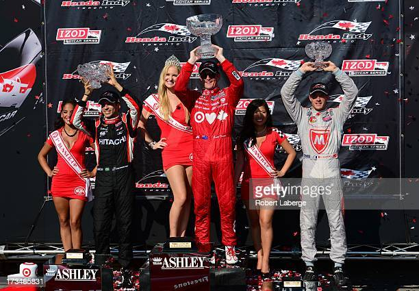 Second place finisher Helio Castroneves of Brazil driver of the Team Penske Chevrolet Dallara Scott Dixon of New Zealand driver of the Target Chip...