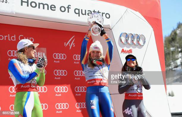 Second place finisher Ilka Stuhec of Slovenia and third place finisher Sofia Goggia of Italy look on as Mikaela Shiffrin of United States celebrates...