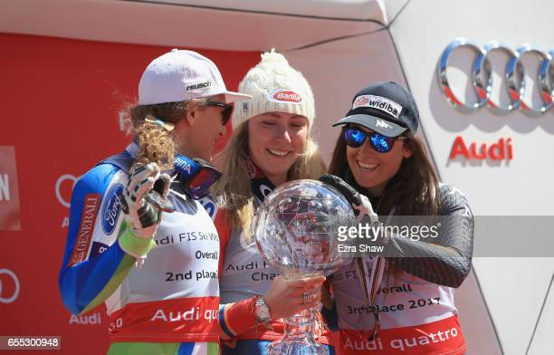 Second place finisher Ilka Stuhec of Slovenia and third place finisher Sofia Goggia of Italy admire the globe that as Mikaela Shiffrin of United...