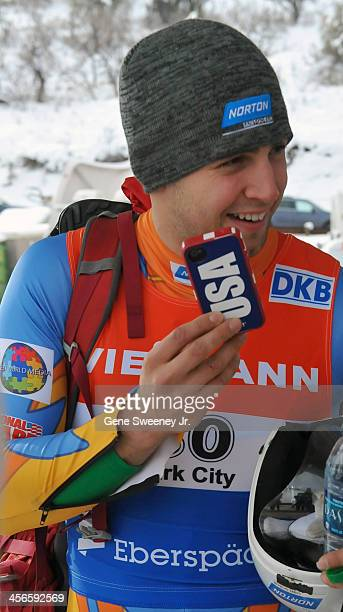 Second place finisher in the Men's Luge competition Chris Mazdzer of the United States is on the phone to his family after competition in day 2 of...
