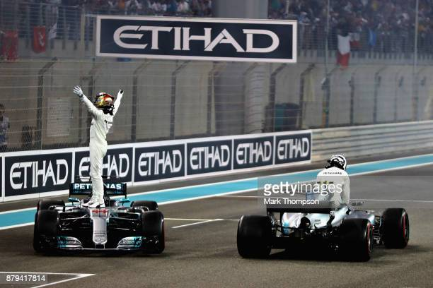Second place finisher Lewis Hamilton of Great Britain and Mercedes GP celebrates on track with race winner Valtteri Bottas of Finland and Mercedes GP...