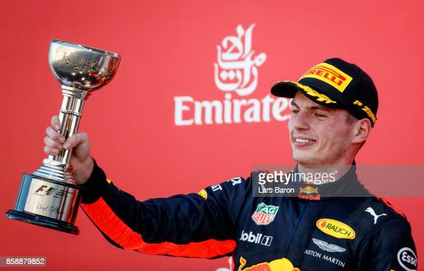 Second place finisher Max Verstappen of Netherlands and Red Bull Racing celebrates on the podium during the Formula One Grand Prix of Japan at Suzuka...