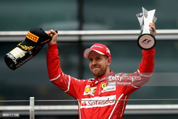 Second place finisher Sebastian Vettel of Germany and Ferrari celebrates on the podium during the Formula One Grand Prix of China at Shanghai...