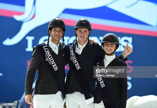 Second place finisher Steve Guerdat of Switzerland first place finisher Jos Verlooy of Belgium and third place finisher Georgina Bloomberg stand on...