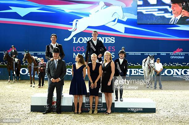 Second place finisher Steve Guerdat of Switzerland first place finisher Jos Verlooy of Belgium and third place finisher Georgina Bloomberg laugh...