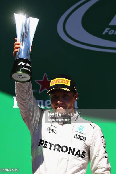 Second place finisher Valtteri Bottas of Finland and Mercedes GP celebrates on the podium during the Formula One Grand Prix of Brazil at Autodromo...