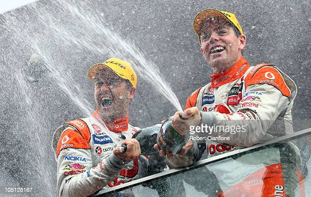 Second place getter Jamie Whincupp driver of the Team Vodafone Holden and winner Craig Lowndes driver of the Team Vodafone Holden celebrates on the...