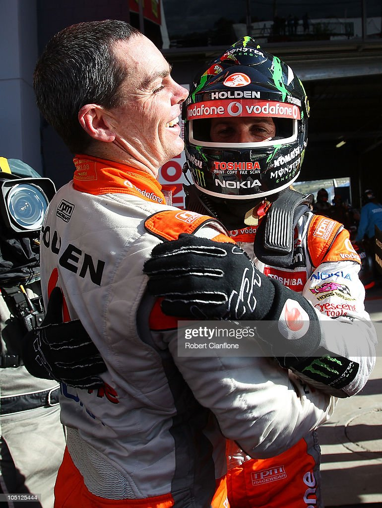 Second place getter Jamie Whincupp driver of the Team Vodafone Holden and winner Craig Lowndes driver of the Team Vodafone Holden celebrate after the...