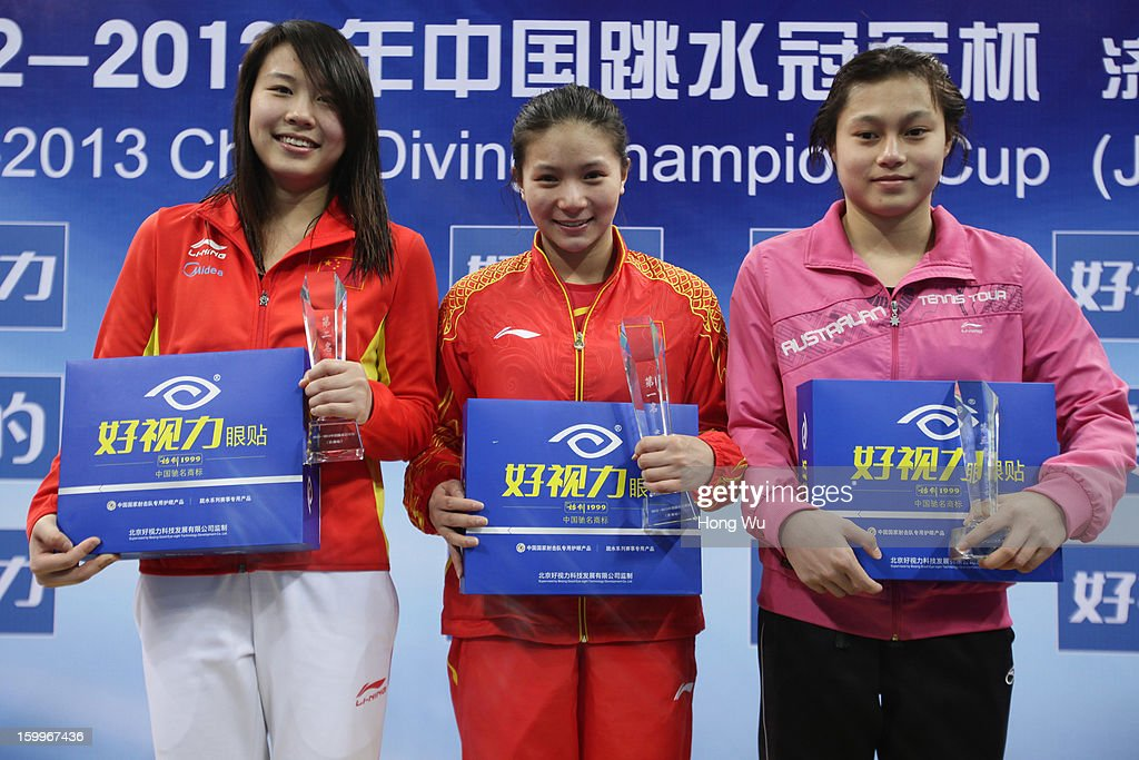 Second place Han Wang, first place Zi He and third place Chunting Wu pose during the award ceremony of the Women's 3m Springboard Diving Final on Day 2 of the 2013 China Diving Champions Cup at Jinan Olympic Sports Center on January 24, 2013 in Jinan, China.