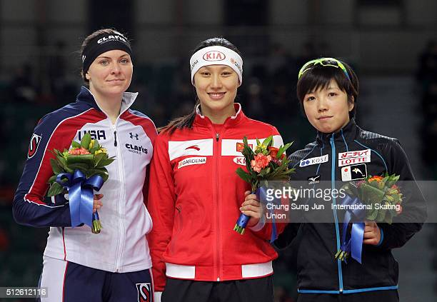 Second place Heather RichardsonBergsma of the United States first place Hong Zhang of China and third place Nao Kodaira of Japan celebrate on the...