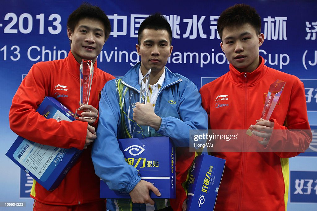 Second place Jian Yang, first place Jun Wu, third place Siyi xie hold their cups during the award ceremony of the Men's 10m Platform Diving Final on Day 2 of the 2013 China Diving Champions Cup at Jinan Olympic Sports Center on January 24, 2013 in Jinan, China.