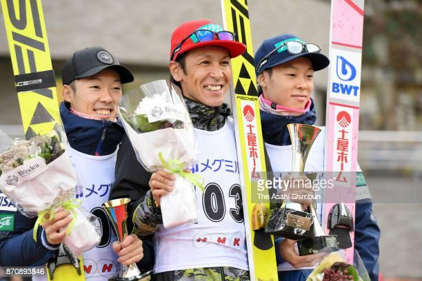Second place Junshiro Kobayashi winner Noriaki Kasai and third place Ryoyu Kobayashi pose on the podium at the award ceremony for the Men's event...