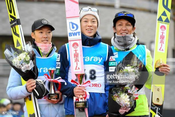 Second place Junshiro Kobayashi winner Ryoyu Kobayashi and third place Noriaki Kasai pose for photographs on the podium after the men's event of the...