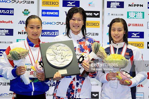 Second place Kanako Watanabe first place Rie Kaneto and third place Runa Imai pose at the medal ceremony for the Women's 200m Breaststroke during day...