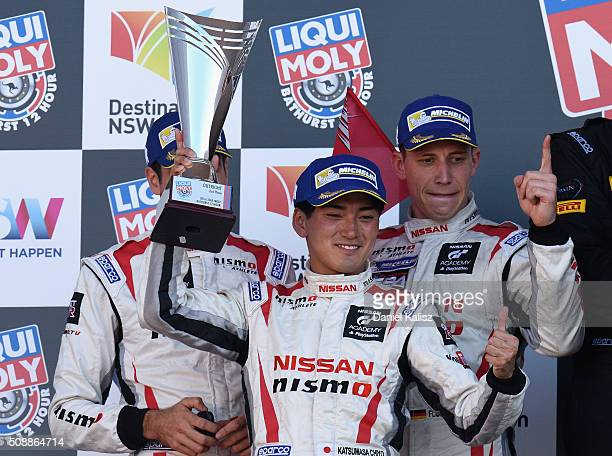 Second place Katsumasa Chiyo Rick Kelly and Florian Strauss drivers of the NISMO Athlete Global Team Nissan GTR NISMO GT3 celebtrate on the podium...