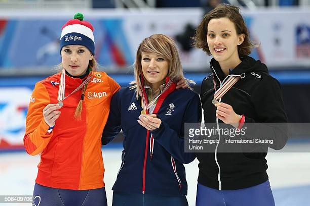 Second place Lara van Ruijven of the Netherlands winner Elise Christie of Great Britain and third place Veronique Pierron of France celebrate with...