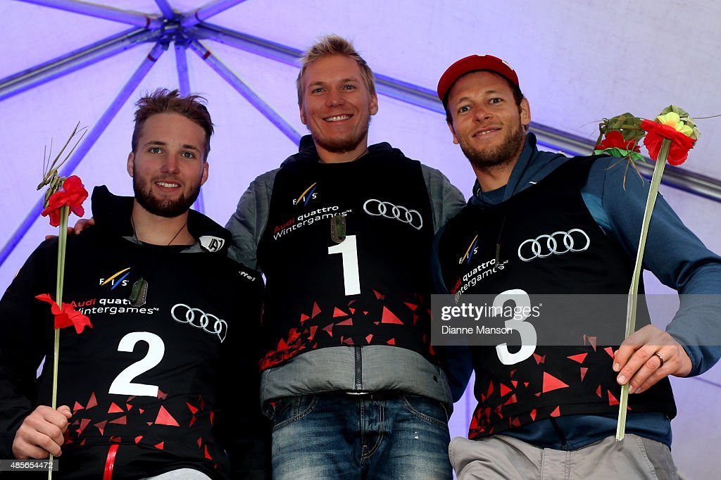 Second place Marco Schwarz of Austria, first place Adam Zampa of Slovakia and third place Marc Gini of Switzerland pose during the medal ceremony for the Alpine Slalom - FIS Australia New Zealand Cup during the Winter Games NZ on August 29, 2015 in Queenstown, New Zealand.