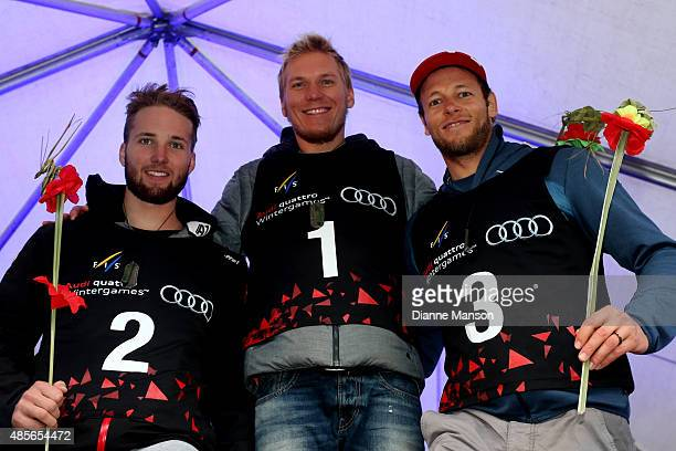 Second place Marco Schwarz of Austria first place Adam Zampa of Slovakia and third place Marc Gini of Switzerland pose during the medal ceremony for...