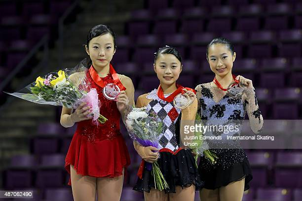 Second place Marin Honda of Japan first place Yuna Shiraiwa of Japan and third place Vivian Le of United States celebrate with their medals following...