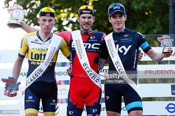 Second place Mike Teunissen of Team Lotto NLJumbo winner Jean Pierre Drucker of BMC Racing Team and third place Ben Swift of Team Sky stand on podium...