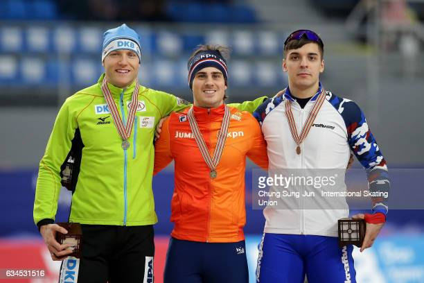 Second place Nico Ihle of Germany first place Jan Smeekens of Netherlands and third place Ruslan Murashov of Russia celebrate during a medal ceremony...