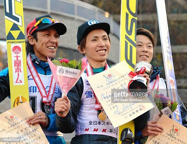 Second place Noriaki Kasai winner Kenji Sakuyama and third place Ryoyu Kobayashi pose on the podium after the All Japan Ski Championships Men's Jump...