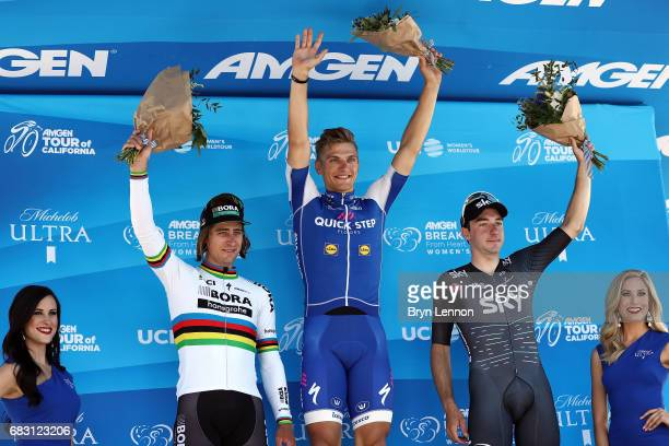 Second place Peter Sagan of Slovakia and for BoraHansgrohe stage winner Marcel Kittel of Germany and Elia Viviani of Italy riding for Team Sky stand...