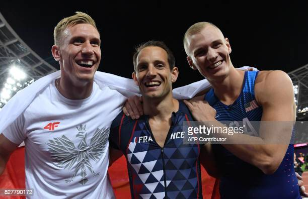 Second place Poland's Piotr Lisek winner US athlete Sam Kendricks and third place France's Renaud Lavillenie celebrate after the final of the men's...
