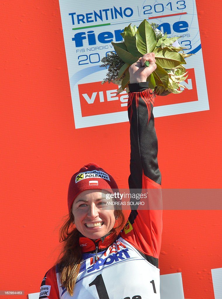Second place Polish's Justyna Kowalczyk celebrates, on March 2, 2013, on the podium of the Women's Cross Country 30 km Classic race of the FIS Nordic World Ski Championships at Val Di Fiemme Cross Country stadium in Cavalese, northern Italy.