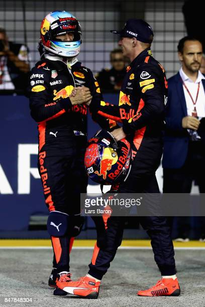 Second place qualifier Max Verstappen of Netherlands and Red Bull Racing and third place qualifier Daniel Ricciardo of Australia and Red Bull Racing...
