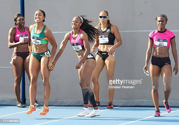 Second place Queen Harrison and first place Brianna Rollins celebrate after winning in the Women's 100 Meter Hurdles final on day three of the 2013...