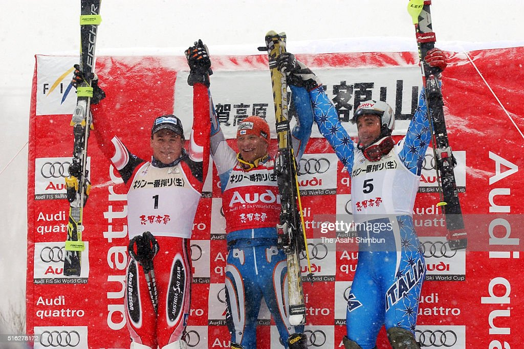 Second place Rainer Schoenfelder of Austria first place Kalle Palander of Finland and third place Giorgio Rocca of Italy celebrate on the podium at...