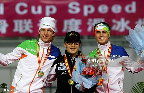 Second place Ronald Mulder of Netherlands first place Joji Kato of Japan and third place Jan Smeekens of Netherlands pose during the award ceremony...